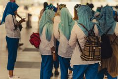 Muslim women wait for friends to travel together royalty free stock photography