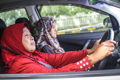 Muslim womens in a car Royalty Free Stock Image