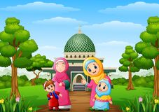 Muslim womens with son and her daughter with mosque in the park Royalty Free Stock Photo