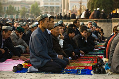 Muslim worshipers kneel on prayer carpets royalty free stock photos