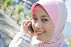 Muslim young girl make a phone call Stock Photos