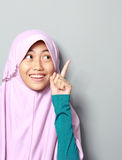 Muslim young girl pointing up Stock Photography