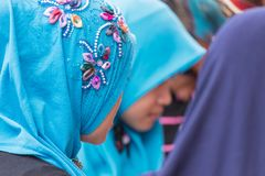 Muslim young ladies wearing bright turquoise hijab Stock Image