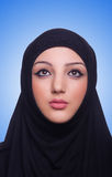 Muslim young woman wearing hijab on white Stock Images