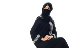 A muslim young women sit and looking to side. In isolated white background Stock Images