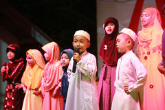 Muslim Youth Singing for Muslim God and Prayer Time Stock Image