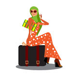 muslimah asian woman with her trolly bag wating and posing for people isolated in white background Royalty Free Stock Photography