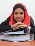 Muslimah business concept. Beautiful young muslim business woman with files, smiling to the camera Stock Photos