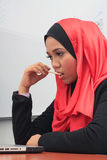 Muslimah business concept. Closeup of a young muslim woman thinking Stock Photos