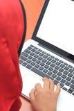 Muslimah business concept. Closeup of a young muslim woman using laptop Stock Photo
