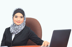 Muslimah business concept. Portrait of a young attractive muslim business woman with laptop Royalty Free Stock Photography