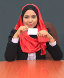 Muslimah business concept. Young asian muslim woman smile to camera while holding white card Stock Images