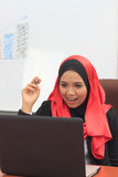 Muslimah business concept. Young asian muslim business woman smiling with laptop Royalty Free Stock Photos