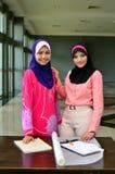 Muslimah business woman smile. Beautiful muslimah asian business women  together Stock Photography