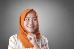 Muslimah Businesswoman Thinking Something, Having Bright Idea royalty free stock image