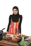 Muslimah concept. Beautiful muslim woman looking to the camera in the kitchen isolated white background Stock Images