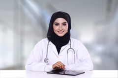 Muslimah doctor isolatedon blur background Stock Images