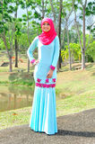 Muslimah lady wear blouse and hijab Royalty Free Stock Images