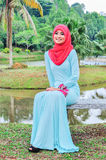 Muslimah lady wear blouse and hijab Stock Images