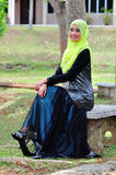 Muslimah lady wear blouse and hijab Stock Photos