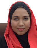 Muslimah portrait. Fashion portrait of young beautiful muslim woman with red and black scarf Royalty Free Stock Image