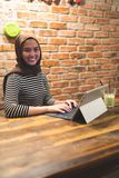 Muslimah woman working at cafe