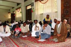 Muslims in a congregation in Africa. A  Muslims  listen to a lecture in Maulid program in Africa Royalty Free Stock Image