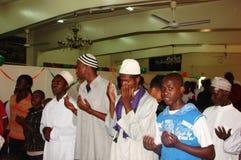 Muslims in Dua (prayer). Muslims perform a prayer in  Africa Nairobi Kenya Stock Image