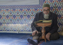 Muslims find peace by reading the Quran at the mosque. Istanbul, Turkey - April 23, 2013: Muslims find peace by reading the Quran at the mosque, Istanbul Royalty Free Stock Photos