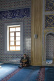 Muslims find peace by reading the Quran at the mosque Stock Images