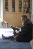 Muslims find peace by reading the Quran at the mosque. Istanbul, Turkey - April 23, 2013: Muslims find peace by reading the Quran at the mosque, Istanbul Royalty Free Stock Image