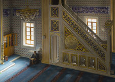 Muslims find peace by reading the Quran at the mosque Royalty Free Stock Photography