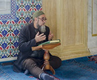 Muslims find peace by reading the Quran at the mosque. Istanbul, Turkey - April 23, 2013: Muslims find peace by reading the Quran at the mosque, Istanbul Royalty Free Stock Photo