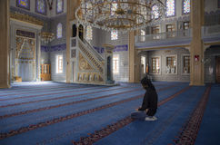 Muslims find peace by reading the Quran at the mosque Royalty Free Stock Images