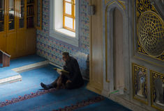 Muslims find peace by reading the Quran at the mosque Stock Photography