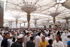 Muslims after Friday prayers  front of the Nabawi Mosque, Medina Stock Photography