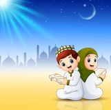 Muslims kids reading books on shiny abstract background Royalty Free Stock Image