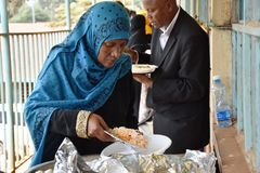 Muslims lady serving food. Muslims ladies serve food in Nairobi Kenya after a conference Stock Photo