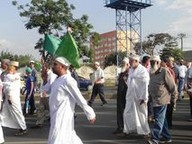 Muslims march in  Nairobi streets. Muslim march in  Nairobi streets Kenya. This happens during a festive holidays such as Eed, Milad un Nabbi Stock Image