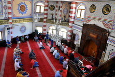 Muslims offer prayer during Ramadan in Kosovo. People offer prayers and read the Quran during the Muslim holy month of Ramadan in a mosque in Prizren, Kosovo Royalty Free Stock Photography