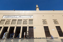 Muslims outside a mosque during prayer time in Dubai. Royalty Free Stock Images