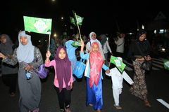 Muslims parade. Muslims were marching in the evening to commemorate religious holidays in the city of Solo, Central Java, Indonesia Stock Photo