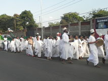 Muslims perform a qasida  in  Nairobi streets. Muslims perform a qasida (islamic song) in  Nairobi streets Kenya. This happens during a festive holidays such as Royalty Free Stock Photography