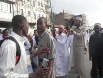 Muslims perform a qasida  in  Nairobi streets. Muslims perform a qasida (islamic song) in  Nairobi streets Kenya. This happens during a festive holidays such as Royalty Free Stock Photo
