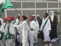 Muslims perform a qasida  in  Nairobi streets. Muslims perform a qasida (islamic song) in  Nairobi streets Kenya. This happens during a festive holidays such as Stock Photo