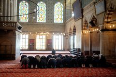 Muslims praying in a mosque Stock Photos