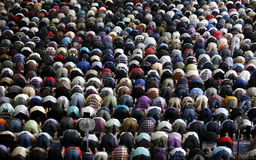 Muslims praying. A Muslim Friday mass prayer royalty free stock photo