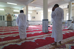 Muslims praying with ihram. Stock Photos