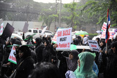 Muslims Protest the Film Innocence of Muslims. A large crowd of Muslim women rally outside the American Embassy protesting against the controversial film Stock Image
