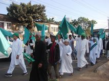 Muslims raising green flags. Muslims  hold flag in one of the Islamic occasion in Africa, Nairobi Kenya. Green symbolizes peace in Islam Royalty Free Stock Photo